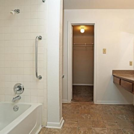 Bathroom with shower bathtub combo with walk-in closet