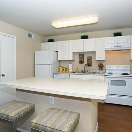 Apartment kitchen with breakfast bar | Monterey Ranch