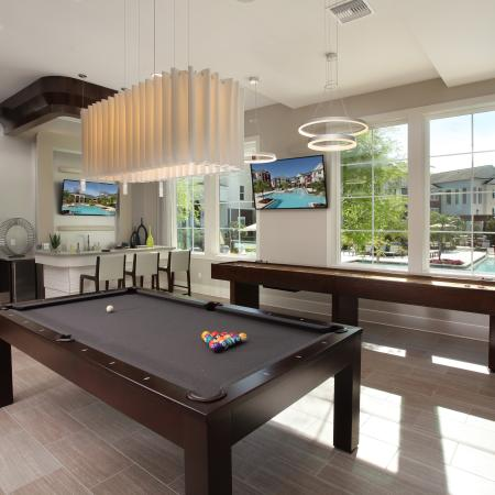 Clubhouse game room with billiards and bar | Village at Terra Bella resident clubhouse