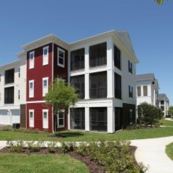 The Village at Terra Bella, exterior, white and red 3 story building, balconies, grass, sidewalk