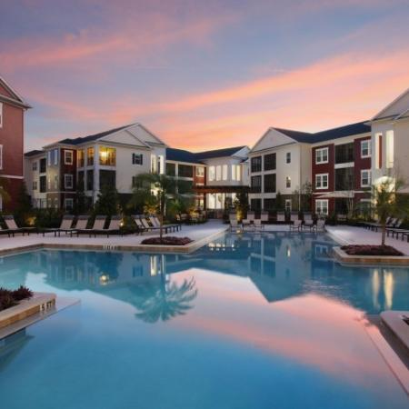 Twilight at apartment community pool | Village at Terra Bella