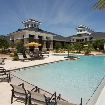 Zero entry pool with poolside chairs and lounges | Village at Terra Bella
