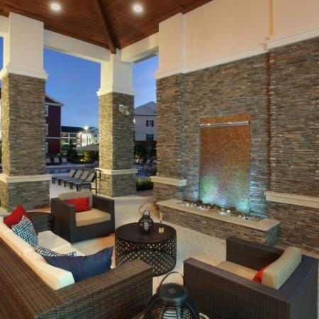 Poolside seating area for residents | The Village at Terra Bella apartment complex