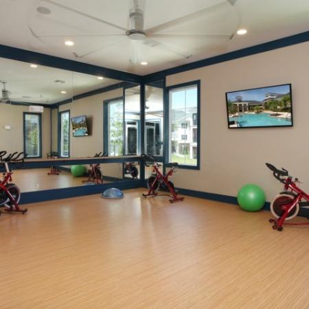 Yoga studio and spinning room | fitness center | Village at Terra Bella apartment complex