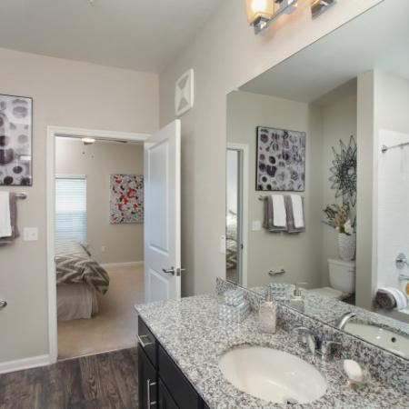 Master bathroom with wood floors, espresso cabinets and granite countertops