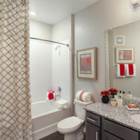Bathroom with shower bathtub combo, espresso cabinets, granite countertops