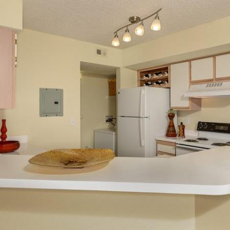 Kitchen will white cabinets and appliances | Royal St George | FL apartments
