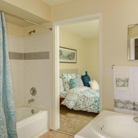 Bathroom with shower and tub combo with tiled wall | Royal St George