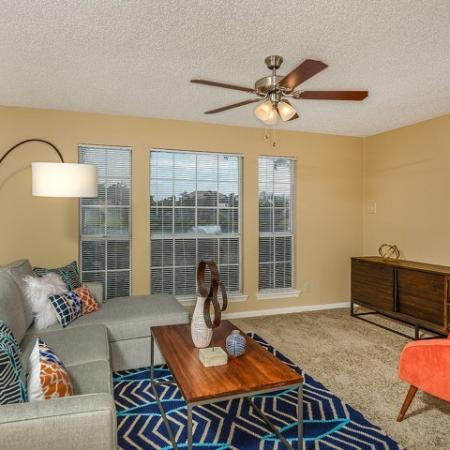 Living room with carpet and ceiling fan | Windward at the Villages 2 bedroom rental