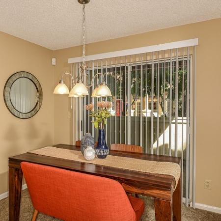 Dining room with sliding glass doors to private patio | Windward at the Villages apartments