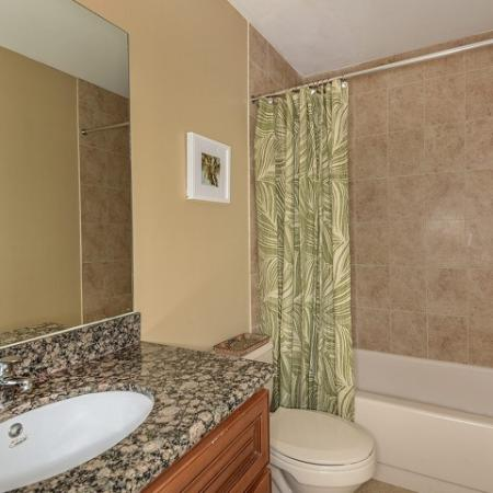 Bathroom with bathtub shower combination with tile walls