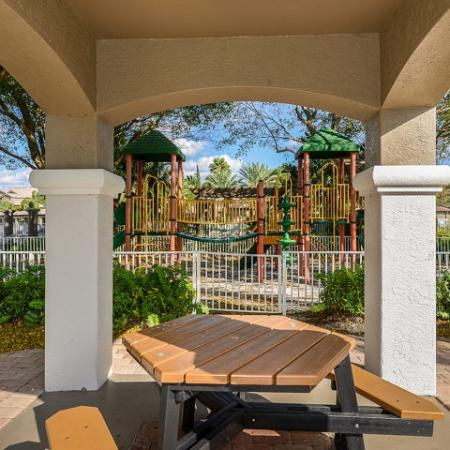 Covered picnic table outside playground | Via Lugano apartments