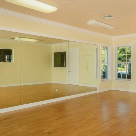 Aerobics room at apartment fitness center | Via Lugano