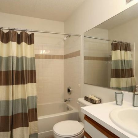 Bathroom with tiled shower and bathtub combo | 1 bedroom apartment at The Pavilions