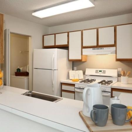 Kitchen with gas range in 2 bedroom apartment at The Pavilions