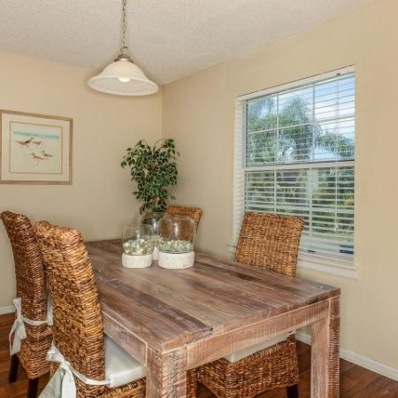Dining room with hardwood flooring in 2 bedroom apartment | The Brittany rentals in Indialantic