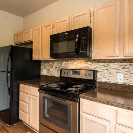 Kitchen with built-in microwave, tile backspash | Austin TX apartments