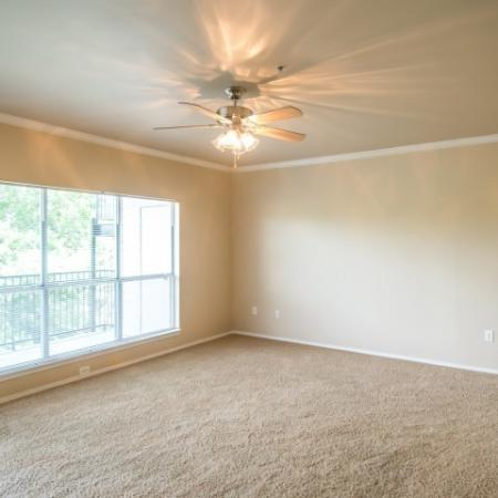 Spacious living room with ceiling fan | Madison at the Arboretum