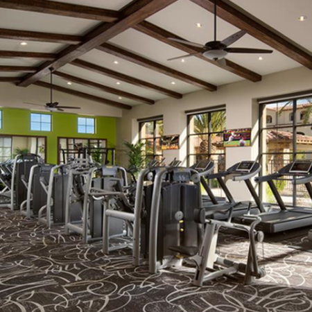 Apartment fitness center with cardio and weight equipment | Villas at San Dorado