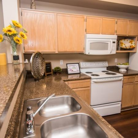 Kitchen with built-in microwave | Madison at Walnut Creek | Austin apartments