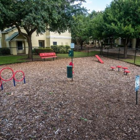 Dog park with agility equipment in pet friendly apartment complex | Sedona Springs