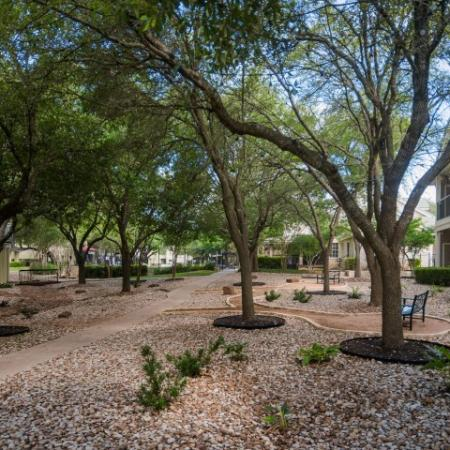 Outdoor space with trees and benches | Sedona Springs apartments in south Austin