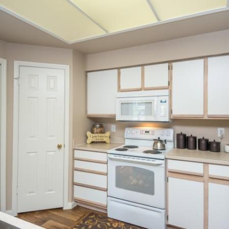 Kitchen with white appliances and white cabinets | Sedona Springs south Austin apartments