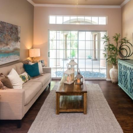1 bedroom apartment living room with hardwood flooring | River Stone Ranch in Austin