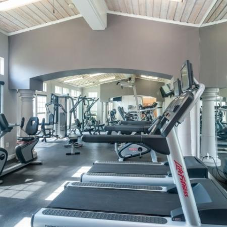 Fitness center cardio equipment at River Stone Ranch apartment gym