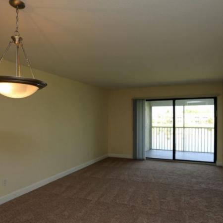 Spacious room with carpet and a balcony | Jupiter Isle