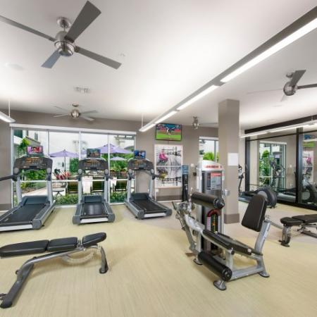 Fitness center with cardio and weight equipment | Rialto apartments