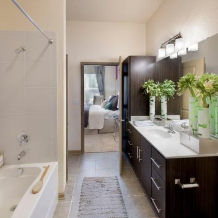 Bathroom with espresso cabinets and tiled showertub combo | Rialto apartments