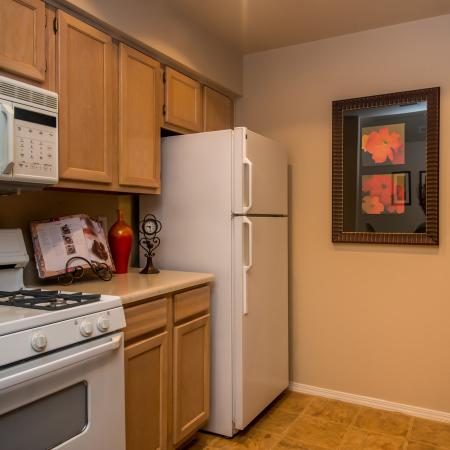 Kitchen with gas stove | Built-in microwave | Madison at Wells Branch