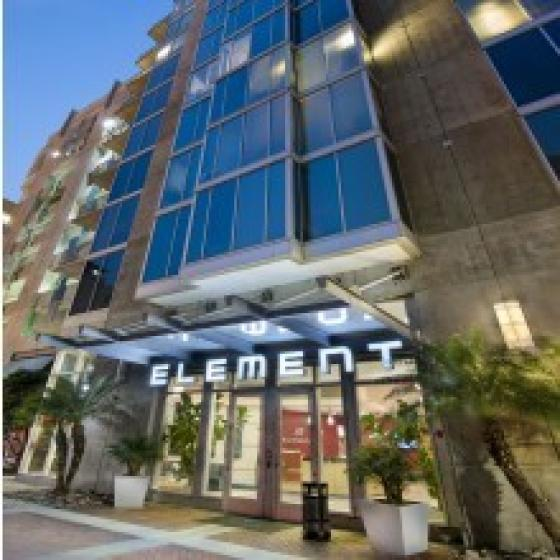 Element, exterior, main entrance, lit sign, multi level building, city street