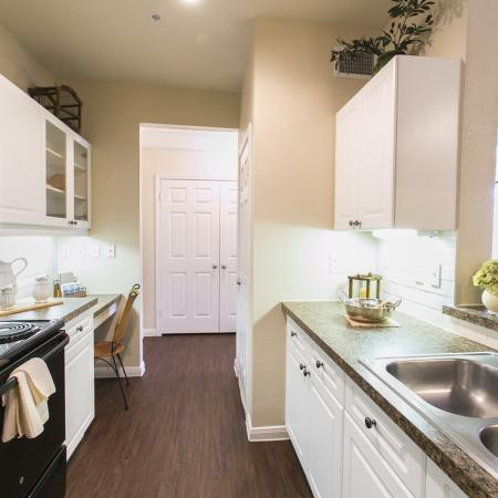 Kitchen with electric appliances and built-in microwave | The Park at Monterey Oaks rentals