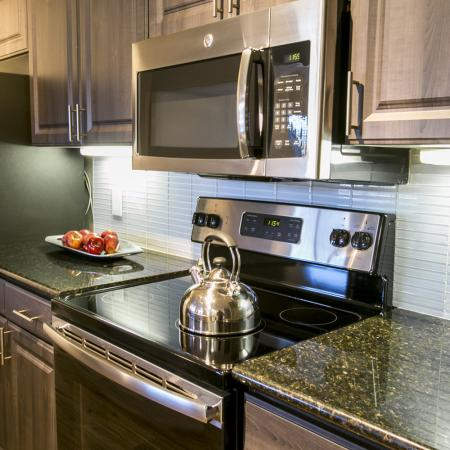 Kitchen with tile backsplash | The Park at Monterey Oaks apartments | south Austin TX