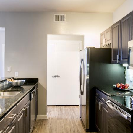 Kitchen with stainless steel appliances | apartments in The park at Monterey Oaks