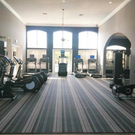 Apartment gym cardio equipment with stair master, treadmills, elliptical | West Palm Beach rental community