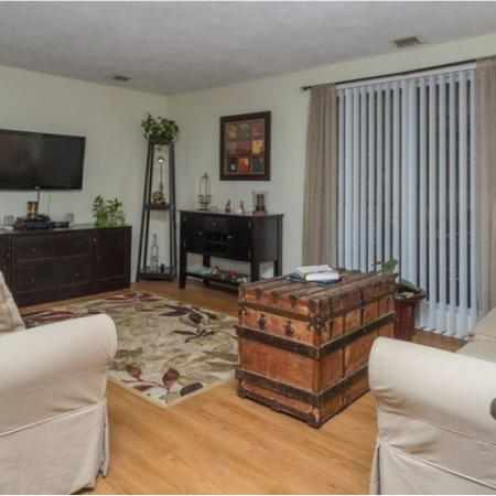 Living room with hardwood flooring | 2 bedroom apartment in Tatnuck Arms complex