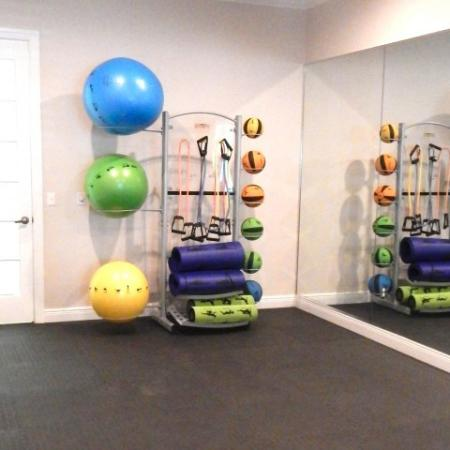 Yoga room in fitness center complete with exercise balls and mats | Grandeville at Saxon apartment gym