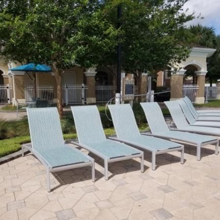 Poolside lounge chairs | Apartment community pool at Grandeville on Saxon