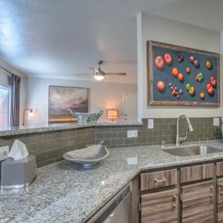 Kitchen with quartz countertopstile backsplash includes dish washer | Albuquerque apartment