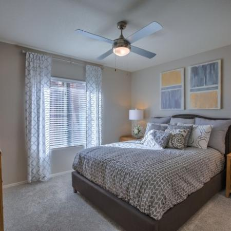 Bedroom with carpet flooring and ceiling fan | Altezza apartment community