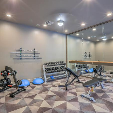 apartment gym weight room with free weights and ballet bar | Altezza apartment gym