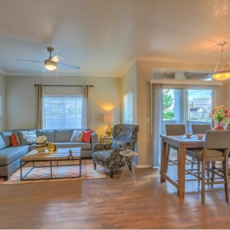 open floor plan with living room and dining room with wood plank style flooring | Arterra apartments