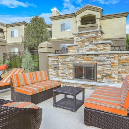 seating area next to outdoor fireplace | apartment community in New Mexico