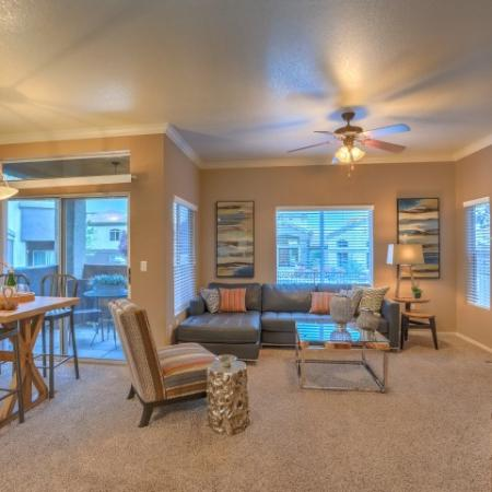 Open floor plan view of living room and dining room in 2 bedroom apartment | Arterra rentals in Albuquerque