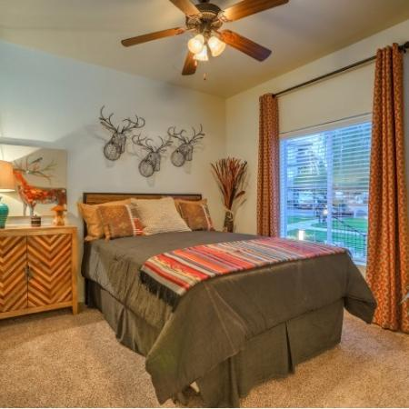 Bedroom with carpet flooring and ceiling fan | Arterra 2 bedroom apartment in Albuquerque
