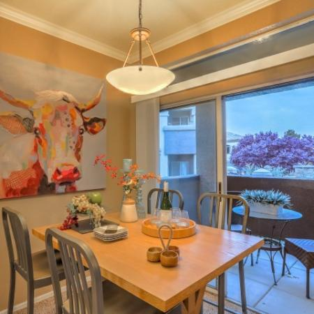 Dining room with sliding glass doors to private patio | Arterra apartment home in Albuquerque