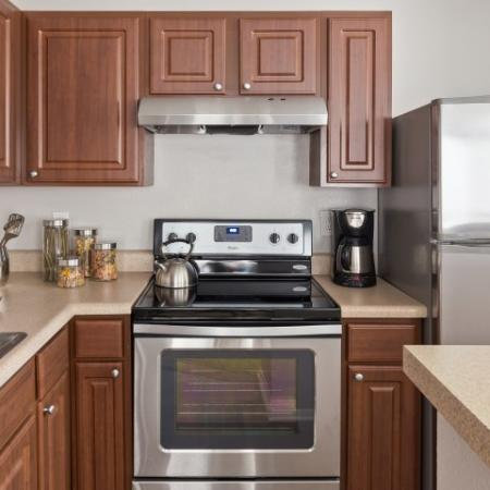 Kitchen with two basin sink and electric appliances | 1 bedroom apartment in Raleigh